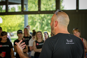TSheets CEO Matt Rissell speaks to employees at the 2015 company picnic